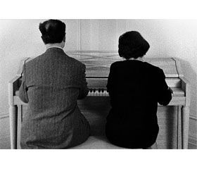 Joaquin Rodrigo and Victoria Kamhi playing the piano four hands